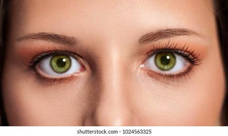 Close up of beautiful green woman eyes