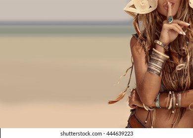 close up of beautiful hippie girl on sea background