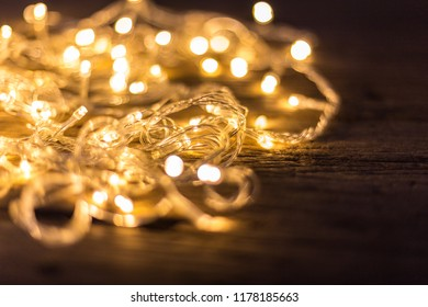 Close up of beautiful LED warm lights on wooden floor background