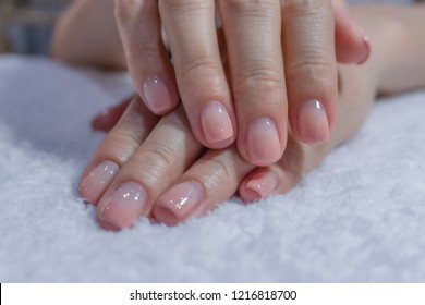 close up beautiful luxury pink nude ombre gel nail art on fashionista woman fingernail toenail,healthy girl doing clean spa pedicure manicure