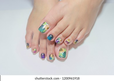 close up beautiful multicolor sparkling glitter gel polish painting cute flowers art on fashionista woman toenails,girl lifestyle do skin care spa pedicure by beautician