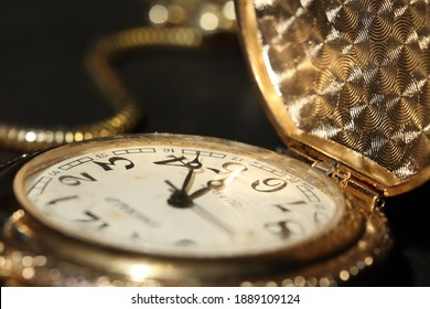 Close up of beautiful pocket watch with golden color
