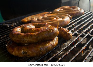 Close up and beautiful Thai sausage grill and white smoke patterns, Pork sausage for camping or lunch or dinner