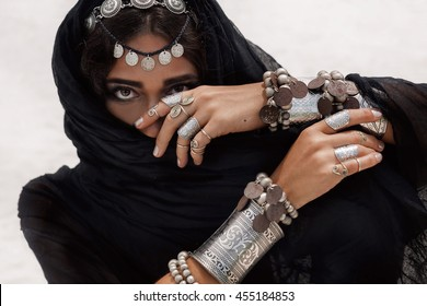 close up of beautiful tribal woman. Hands of ethnic dancer. Soft focus