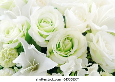 Close up beautiful white rose and flowers on vase in soft focus concept