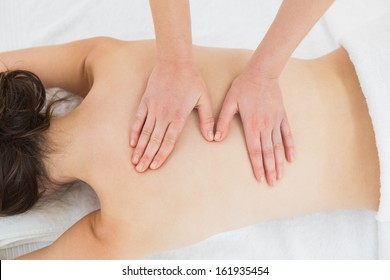 Close up of a beautiful woman enjoying back massage at beauty spa