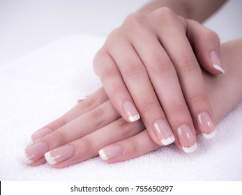 Close up of beautiful Woman Hands. Spa and Manicure concept. Female hands with french manicure. Soft skin, skincare concept. Beauty nails. over beige background