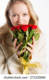 Close up of beautiful  woman with red roses in her hands on white background