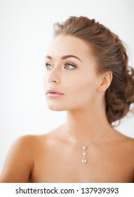 close up of beautiful woman wearing shiny diamond necklace