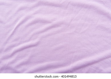 Close up of beautiful wrinkle purple fabric texture.