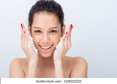Close up of beautiful young woman with cleansing foam for skin care on white background with Copy space for text or product