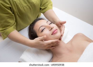 Close up of Beautiful young woman having head or face massage in spa salon wellness, Beauty healthy lifestyle and relaxation concept.