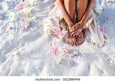 close up of beautiful young  woman legs on the beach at sunset