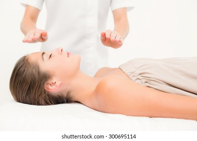 Close up of a beautiful young woman on massage table over white background