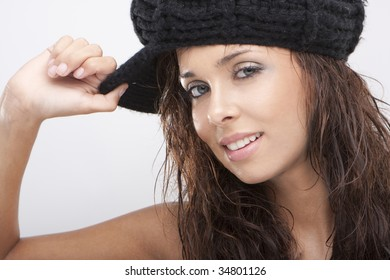 Close up of a beautiful young woman smiling wearing black hat
