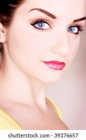 A close up of a beautiful young woman. Studio/Beauty shot.