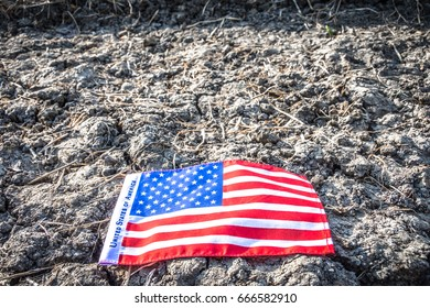 Close up Beautifully star and striped United States of America flag  on the ground  background with space for text