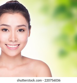 close up of Beauty asian woman Face with green background for skin care concept, model is a beautiful asian girl
