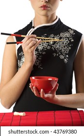 close up of a beauty asian woman in oriental dress with a red cup and chopstick