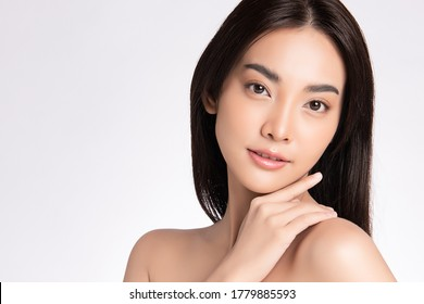 close up Beauty face. Smiling asian woman touching healthy skin portrait. Beautiful happy girl model with fresh glowing hydrated facial skin and natural makeup on white background, - Shutterstock ID 1779885593