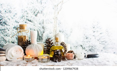 Close up of beauty and fashion concept with spa setting for wellness center. Beautiful composition of spa cosmetic products concept, massage and treatment in winter with snowflake and pine cones