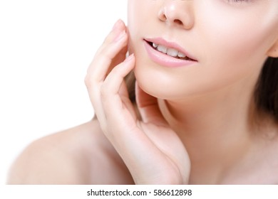 Close up of beauty fashion woman lips with natural Makeup. Matte lipstick. Portrait of Beauty girl face, neck close up. Nude Colors, Isolated on a white background.