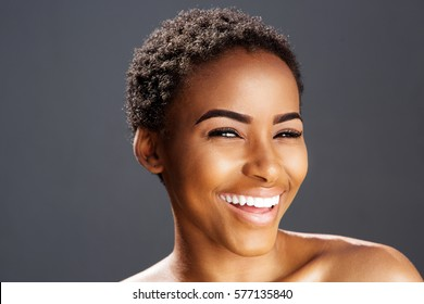Close up beauty portrait of african american fashion model smiling