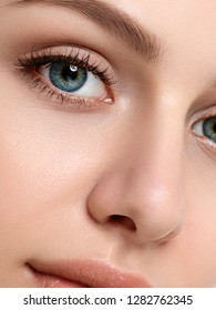 Close up beauty portrait of young caucasian woman. Cleaning face, perfect skin, skincare and cosmetology concept. Extreme closeup, partial face view