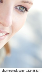 Close up beauty portrait of a young caucasian healthy woman eye looking down with lush and long eyelashes.