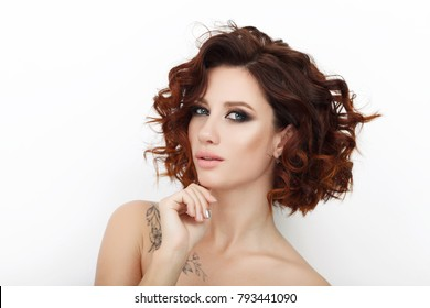 Close up beauty studio shot of beautiful redhead woman with gorgeous makeup curly hair