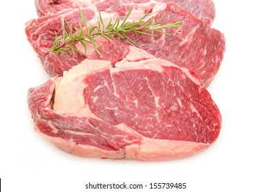 Close up beef entrecote with rosmary on white