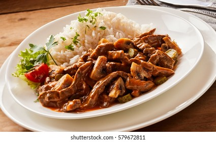 Close up of Beef goulash stroganoff on rustic background on a white plate
