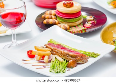 close up beef steak with pancake on dining table