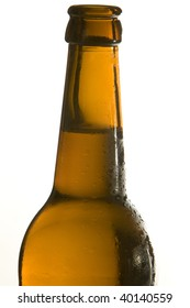Close up of a beer bottle with fresh and cold beer. Studio shot. Isolated on white. With plenty copy-space.