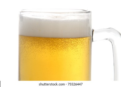 Close up of Beer in a mug with froth on top