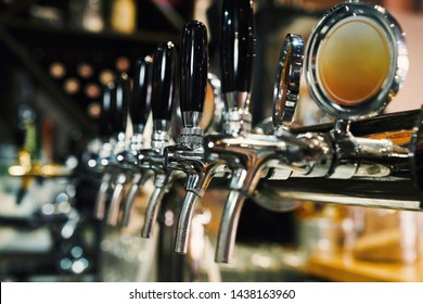 Close up of beer taps in row. Metallic equipment for bars and mini brewerys. Concept of modern equipment.
