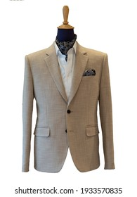 Close up of beige jacket suit with white shirt and ascot tie scarf on white background