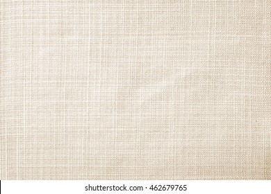 Close up beige table cloth fabric texture wallpaper background