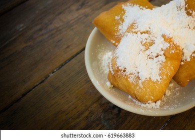 Close up of Beignets on Plate with Wooden Table Background; New Orleans Dessert (Copy Space) #2
