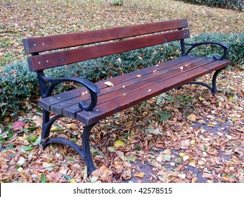 close up bench in park in autumn