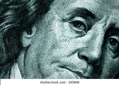 close up of Benjamin Franklin on a one hundred dollar bill