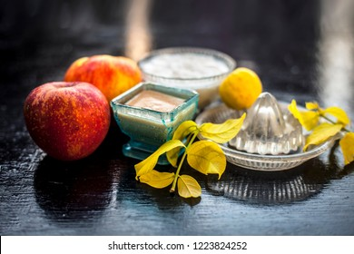 Close up of best home remedy or face pack for better skin complexion on wooden surface i.e. Apple pulp well mixed with lemon juice and curd.