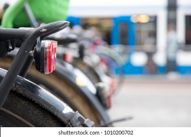 Close up of bicycles in a row with soft urban background.