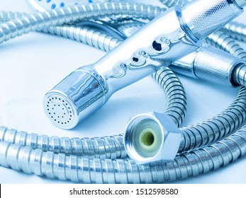 close up bidet shower material and metal cable is spiral pipe in bathroom very shiny on white background. Design concept is cool light blue color