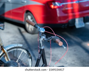 Close up of bike handle bars and bell parked on street