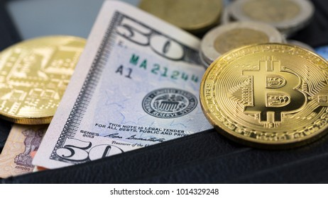 Close Up Of Bitcoin On US Dollar Banknote Inside Black Leather Wallet, Selective Focused. Electronic Money And Real Currency Exchange Concept.
