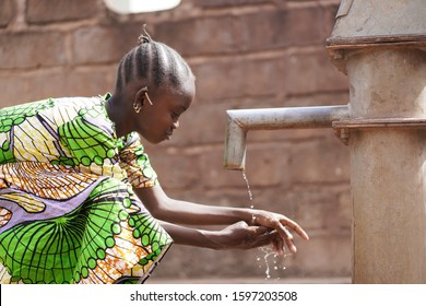Close Up of Black African Hands Washing with Fresh Water