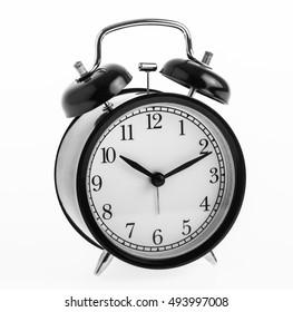 close up black alarm clock isolated on white background