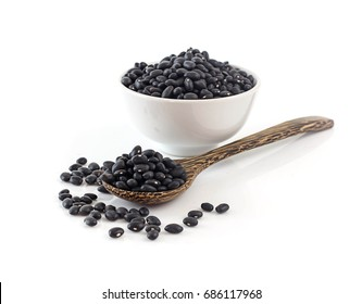 Close up of black beans on white background