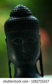 Close up of black Buddha bust idol